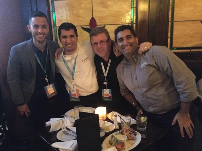 Gus Melendez, Damien Phillippi, and Jayvin Arora at dinner