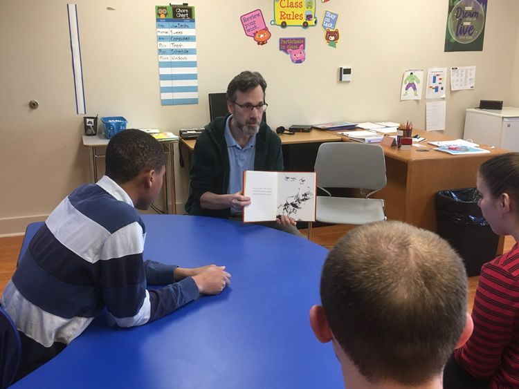 Steve Lane reading to students