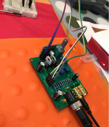 Close up of the Raspberry Pi connected to the Squawker Talker which forwards the audio to the Billy Bass speaker and moves the body