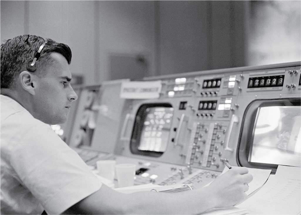Astronaut Roger B. Chaffee is shown at console in the Mission Control Center, Houston, Texas during the Gemini-Titan 3 flight.