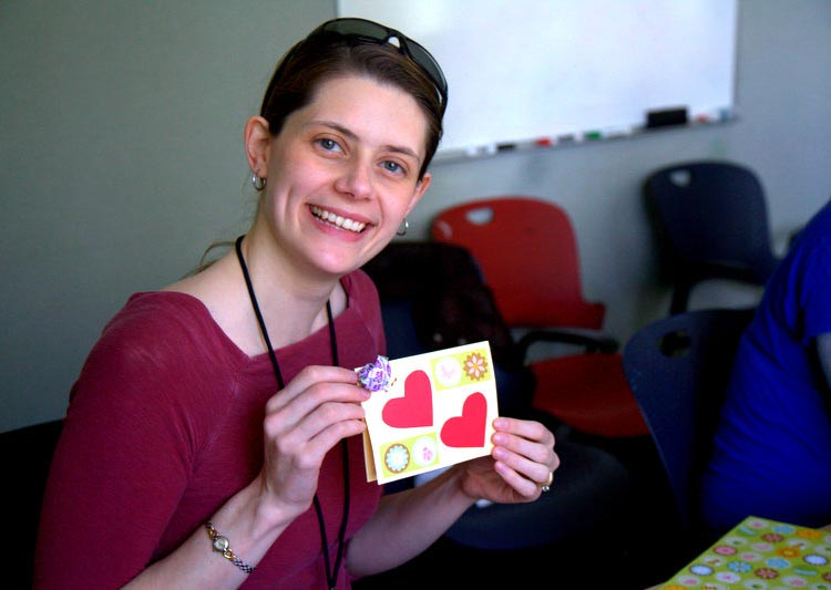 Gillian Gentry making Valentine's Day cards while voluneering at the Homeless Services Center in Santa Cruz, CA